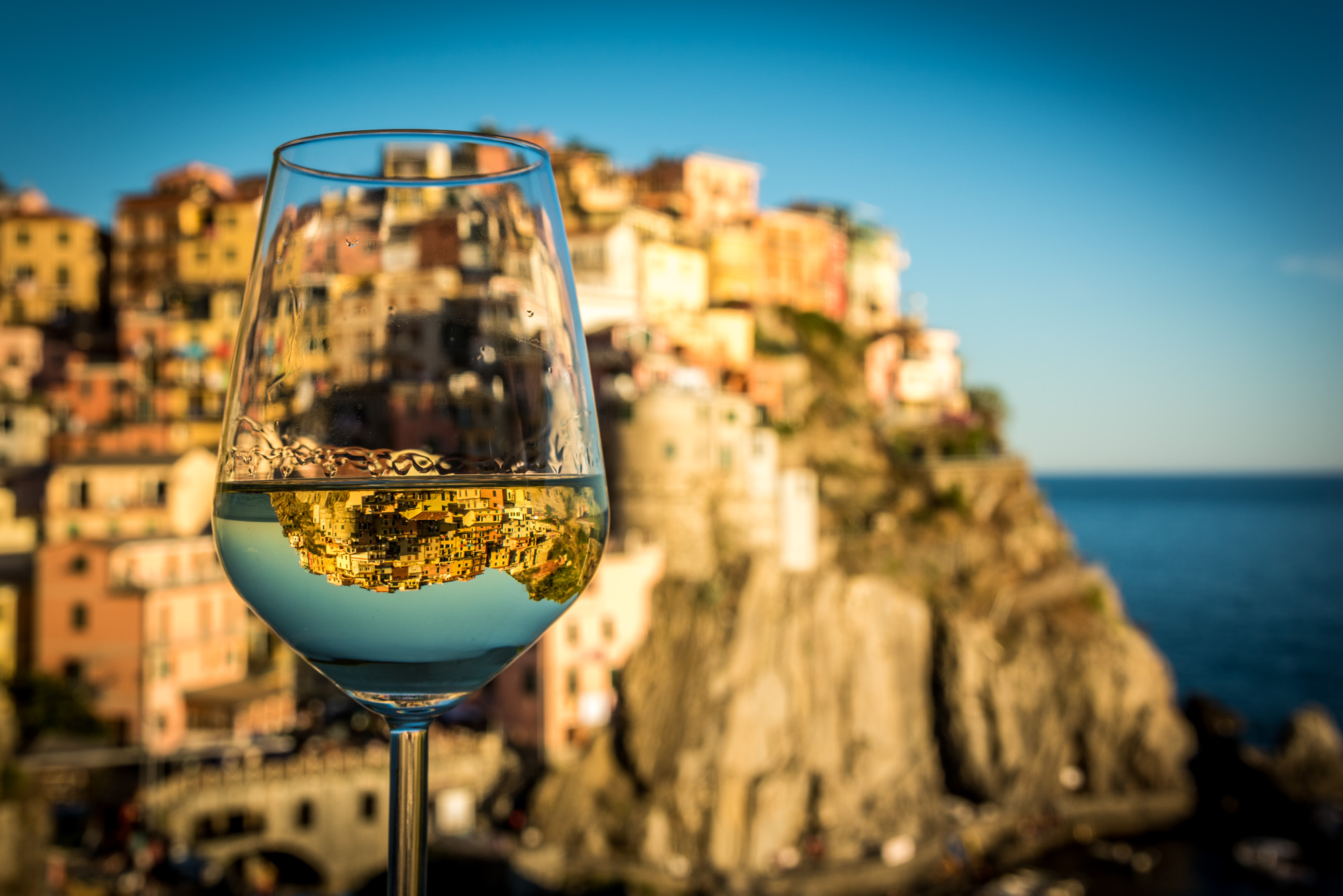 reflection of manarola in a glass