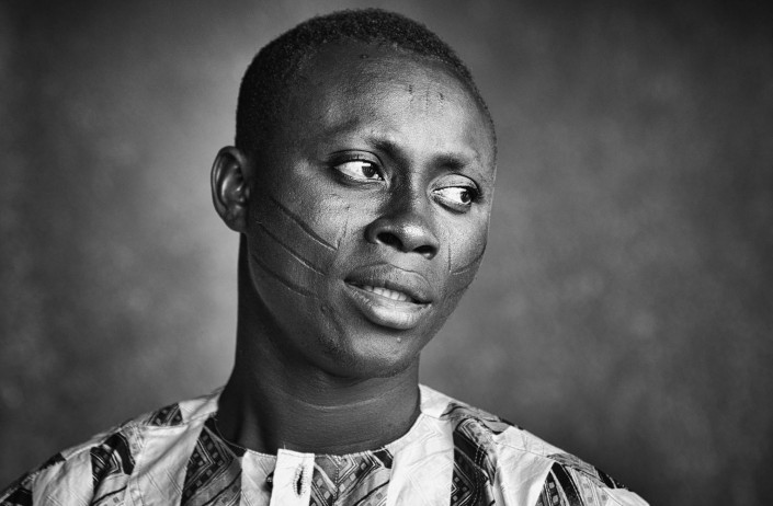young man in Benin with scarification marks