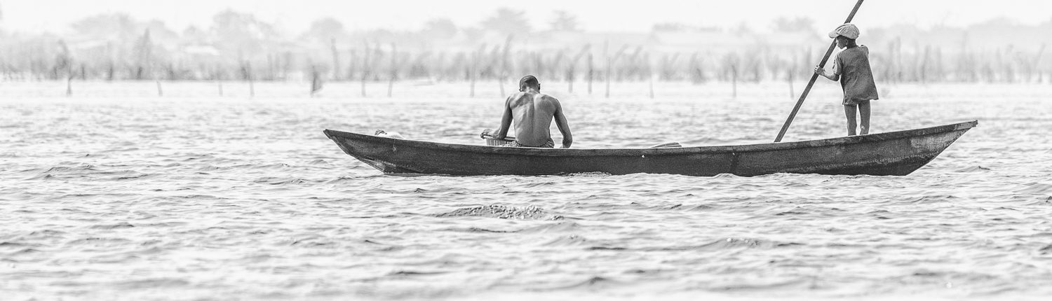 traditional fishing boat on nokwe lake in benin