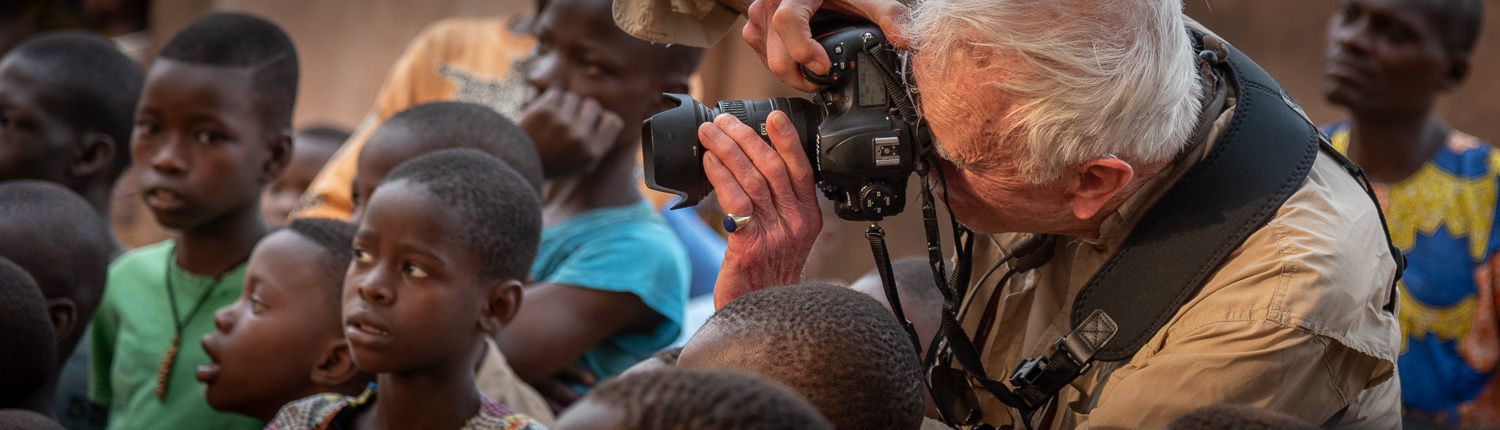 photographer in africa taking pictures during a ceremony