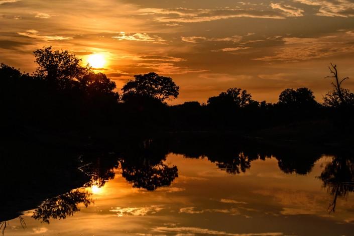 Sonnenaufgang ueber dem Okavango Delta