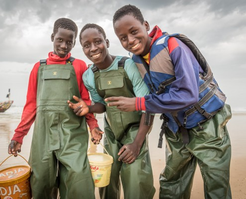 Senegal, young fishermen in the village of Kayar
