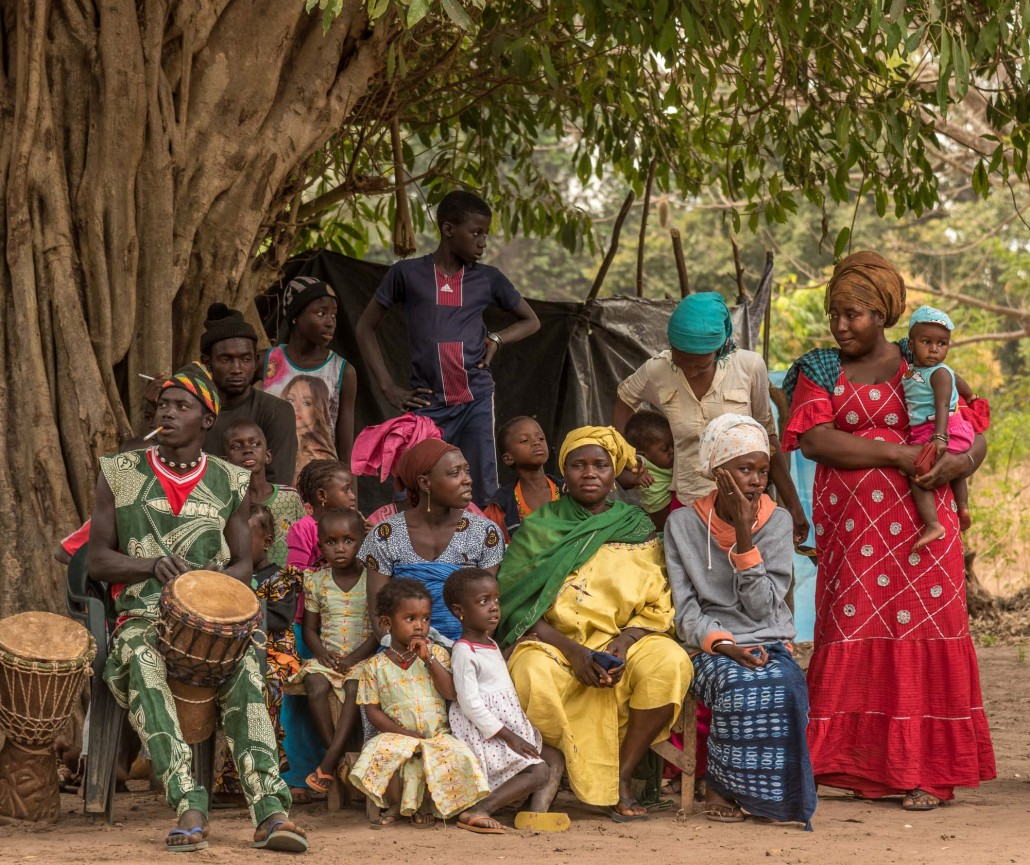 Guinea Bissau spectators of the ceremony under a tree