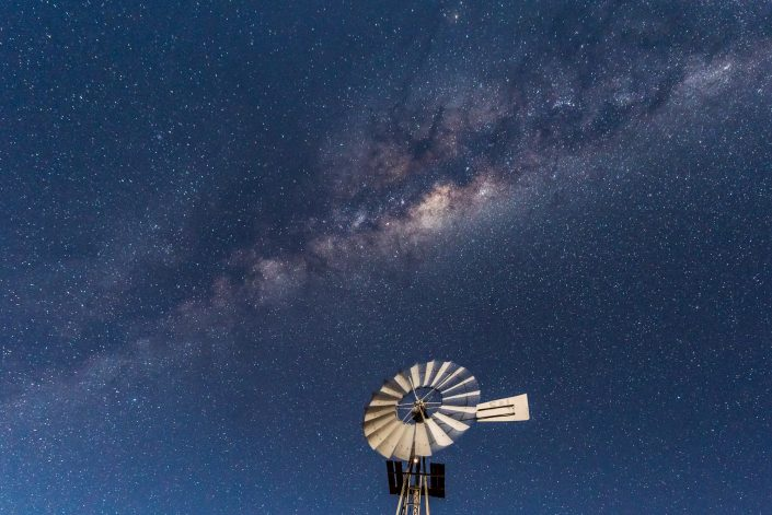 milky way in namibia, night picture with waterpump