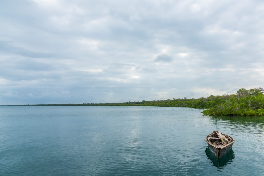 peaceful scene with a boat and the cloudy sky in kilwa in southern tanzania