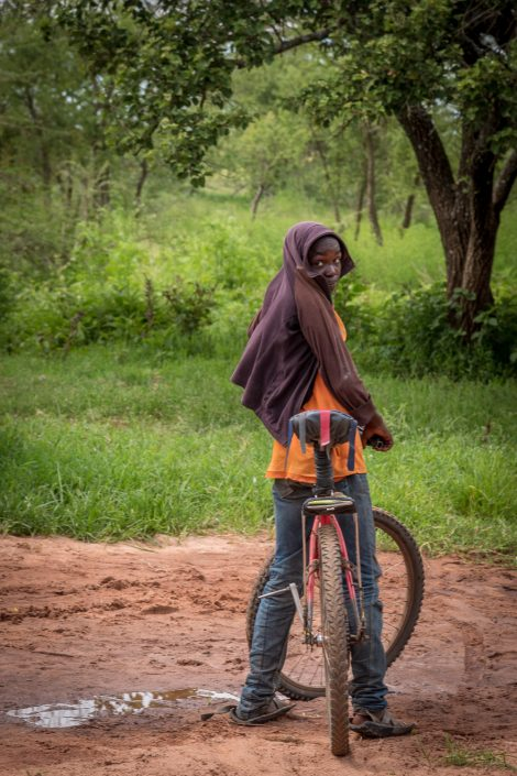 Loiborsoit, Tanzania, Africa. Little maasai boy with his bicycle