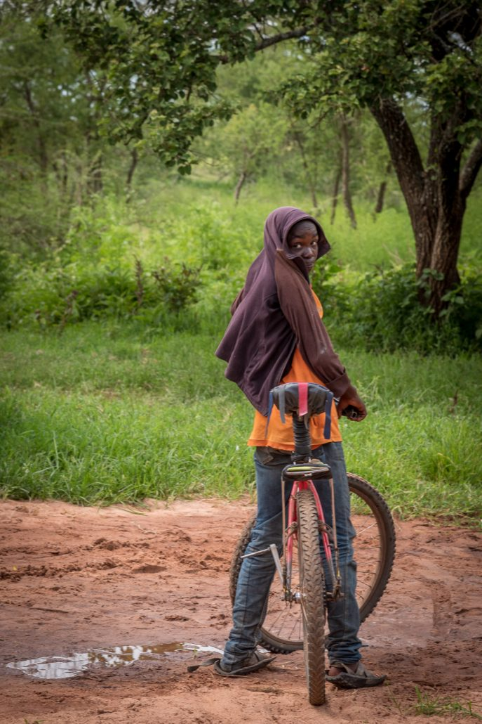 Little massai boy with his bicycle