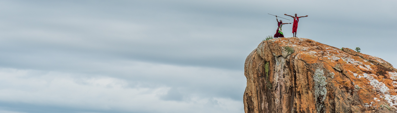 massai on a rock in tanzania