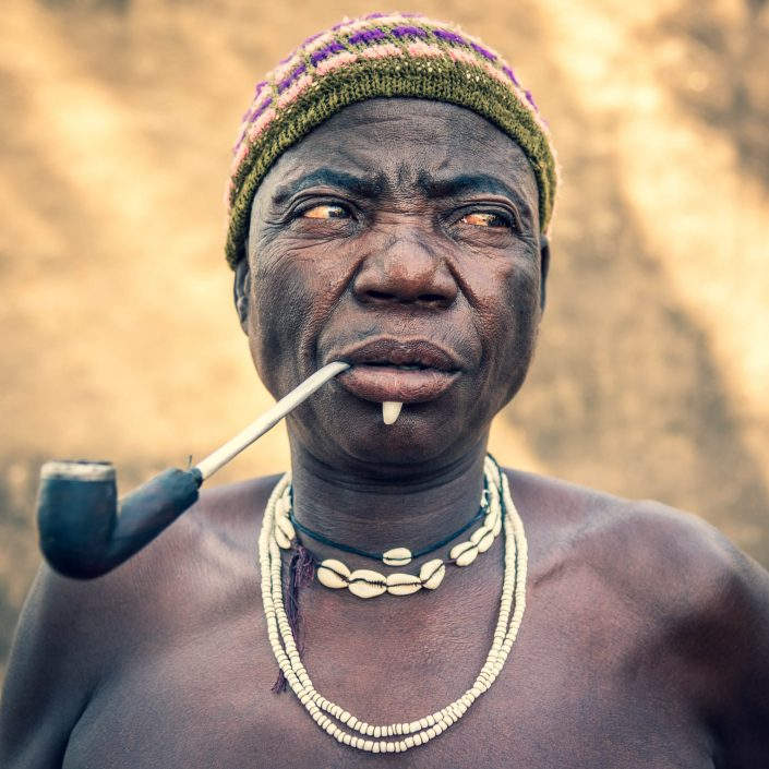 Woman in Koutammakou with wild boar teeth decoration