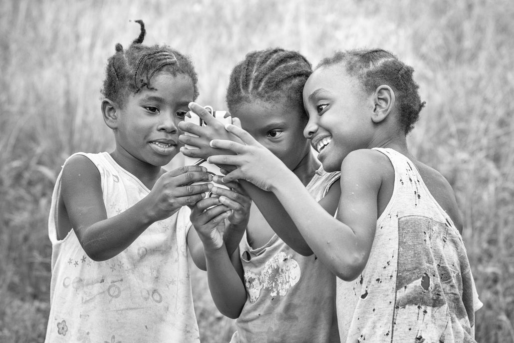 playing kids with mobile phone