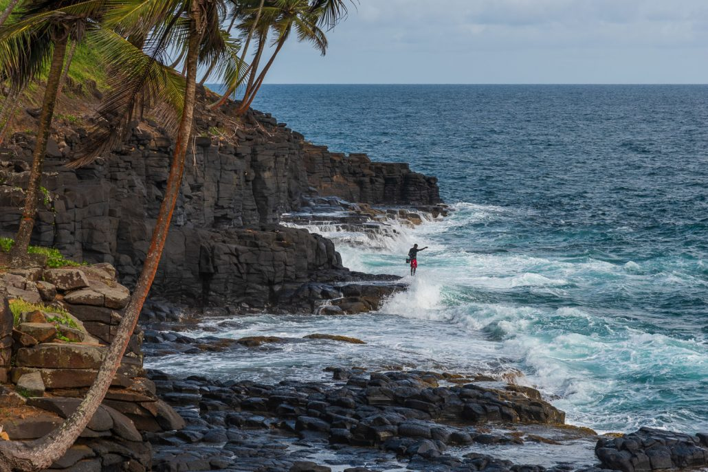 Fishing in the waves in Sao Tomè